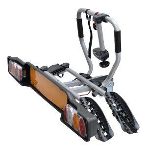Вело багажник Peruzzo Siena 669 с монтаж на топката на теглич от стомана с носещи релси, със светлини и номер, за два велосипеда с общо тегло до 34 кг.