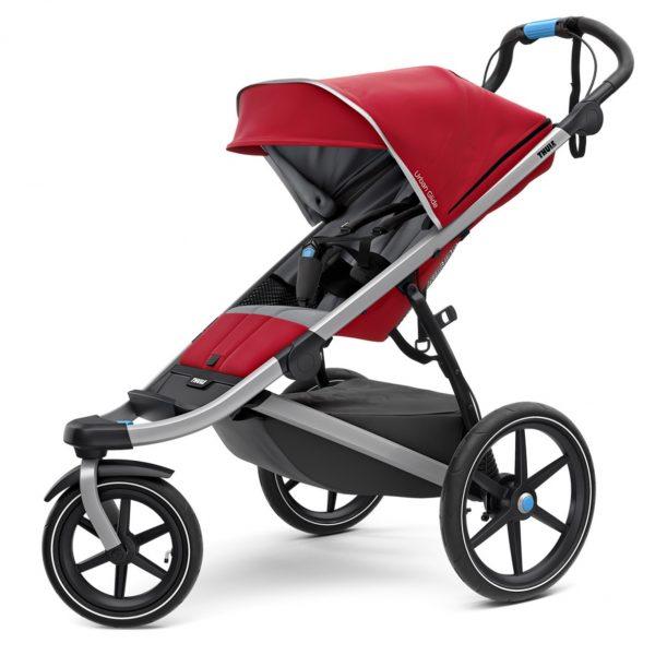 Спортна детска количка за джогинг Thule Urban Glide 2 в червено за бягане с помпащи се гуми, маневрена, високо проходима за пътеки в гората или градината