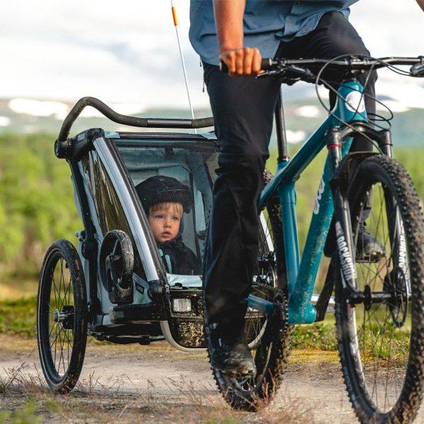 Детска Количка Ремарке Мултиспорт Thule Chariot Cross е детска количка с възможност за трансформиране в количка за вървене, джогинг, ски, велосипед, колело